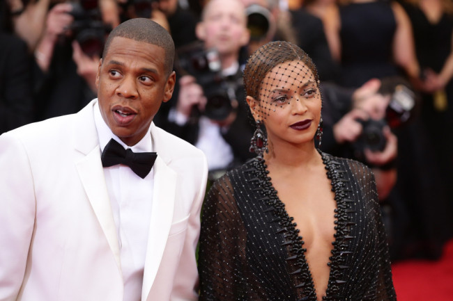 """NEW YORK, NY - MAY 05: Beyonce and Jay-Z attend the """"Charles James: Beyond Fashion"""" Costume Institute Gala at the Metropolitan Museum of Art on May 5, 2014 in New York City. (Photo by Neilson Barnard/Getty Images)"""